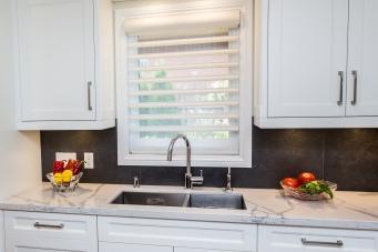 white blinds in kitchen window