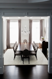 Wooding dining set on a white area rug
