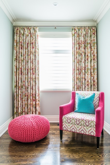 Pink chair and custom drapery